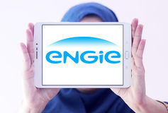 Engie logo. Logo of energy and home services company engie on samsung tablet holded by arab muslim woman royalty free stock photos