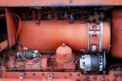 Engine. Close-up of orange tractor engine Stock Photos