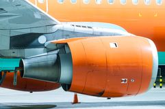 Engine of the airplane painted in orange. Close-up Stock Images