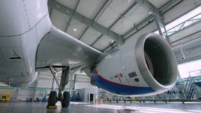 Engine of the airplane under heavy maintenance. Engine of modern passenger jet plane. Front view. Aircraft air intake