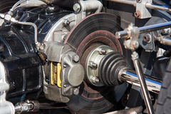 Engine and brakes. Detail of an engine and disc brakes of a race car Royalty Free Stock Photography
