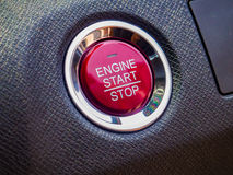 Engine car start or stop button on the general modern car Stock Photos