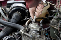 Engine check up. Check out of broken car engine Royalty Free Stock Images