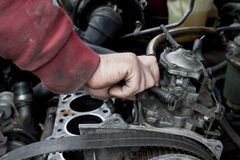 Engine check up. Check out of broken car engine Royalty Free Stock Photo