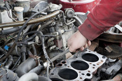 Engine check up. Check out of broken car engine Royalty Free Stock Photography