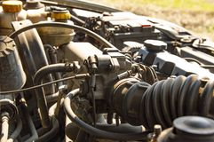 The engine compartment of the car under the hood stock photo