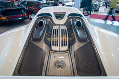 The engine compartment of a mid-engined plug-in hybrid sports car Porsche 918 Spyder, 2015. Stock Image