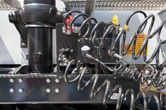 Engine and compressed air hoses of a truck. Royalty Free Stock Images