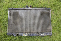 Engine cooling radiator. On the grass, the old version Royalty Free Stock Photo