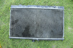 Engine cooling radiator. On the grass, the old version Stock Photography