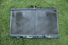 Engine cooling radiator. On the grass, the old version Stock Photos