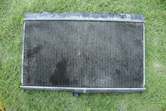 Engine cooling radiator. On the grass, the old version Royalty Free Stock Photos