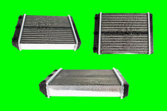 Engine cooling radiators. Many engine cooling radiators isolated on green background. Auto spare parts for passenger car. Chromakey Royalty Free Stock Image