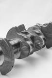 Engine crankshaft. Motor vehicle crankshaft close up isolated Royalty Free Stock Image