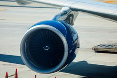 Engine of Delta Airlines passenger airplane. Atlanta, Georgia, USA - October 13, 2016: Engine of Delta Airlines passenger airplane, which is loaded with cargo at Royalty Free Stock Images