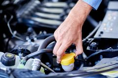 Car detailing series : Cleaning car engine. Close-up engine. Engine detailing in a new car. Car check before purchase. The concept of buying a new car Royalty Free Stock Images