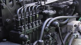 Engine details. Diesel engine. Metal tractor engine at the exhibition stock video