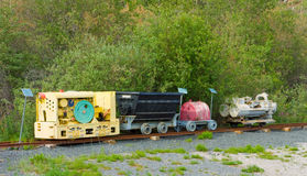 An engine-driven compressor and bin set on tracks to be used underground during the goldrush in yellowknife Royalty Free Stock Image