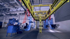 Engine factory. Motors moving on the conveyor. Industrial conveyer with motors works stock footage