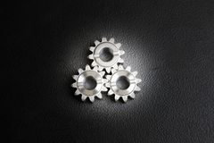 Engine gear wheels. Close up engine gear wheels on black background royalty free stock photo