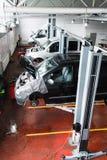 Engine installing conveyor, car production Royalty Free Stock Photo