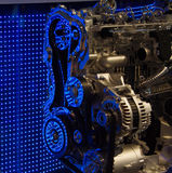 Engine internals with blue LED reflections. Cut out of motor engine, displayed in front of a blue LED wall Stock Photo