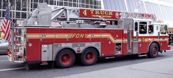 Fire Department Truck in New York City. An FDNY Fire Truck parked on the side of 42nd Street in New York City, Manhattan stock photos