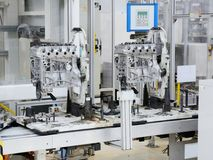 Engine manufacturing. Production line for manufacturing of the engines in the car factory Stock Photo