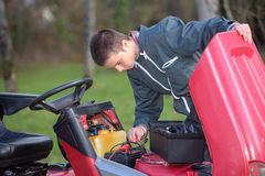 Engine mechanic on call. Small engine mechanic on call royalty free stock photo