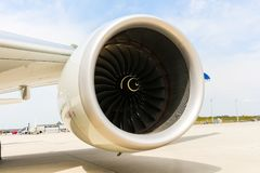 Engine of modern passenger jet airplane. Rotating fan and turbine blades. A Engine of modern passenger jet airplane. Rotating fan and turbine blades stock image