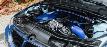 Engine motor of blue car under hood Royalty Free Stock Images