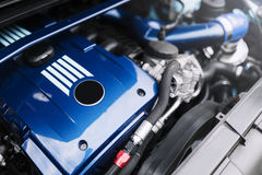 Engine motor of blue car under hood Stock Image