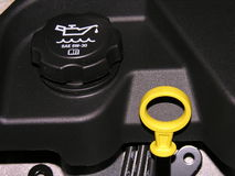 Engine oil dipstick and oil cap. Stock Photo