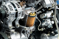 Engine oil filter cross section display inside machine motor in Stock Photos