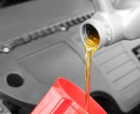 Oil pouring from canister, closeup. Engine oil pouring from canister, closeup royalty free stock photography