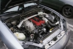 The engine of the old car, the bonnet is open stock photography