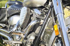 Engine and other chrome parts of motorcycle. Royalty Free Stock Photos