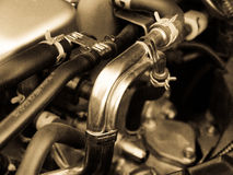 Engine pipes. Car engine with fuel and cooling pipes, monochrome royalty free stock photo
