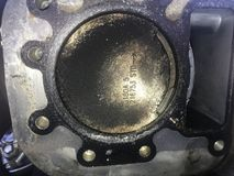 Engine piston with chunk missing Stock Image