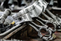 Engine piston removed from the engine bore for repair, machine equipment and damaged from the industry work Royalty Free Stock Photography
