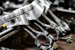 Engine piston removed from the engine bore for repair, machine equipment and damaged from the industry work Royalty Free Stock Photos