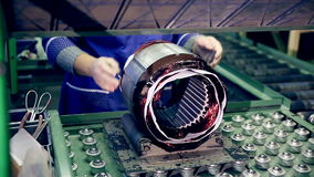 Engine production factory. Electric engine production process. Electric motors automatic robot assembly stock video