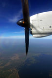Engine and propeller of the plane on the blue sky Stock Photography