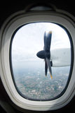 Engine and propeller view from window airplane. Engine and propeller of the plane, view from window airplane royalty free stock images