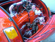 Engine of red 500. Inside view of 500 engine parts - old car royalty free stock images