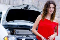 Engine repair. Frustrated repair in woman car Stock Photo