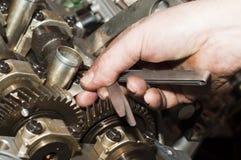 Engine repair close up. In hands tool Stock Photo