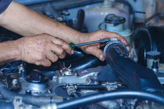 Engine repair,Mechanic working in a car under the hood. Engine repair,Mechanic working in a car under the hood,Engine repair service station Stock Images