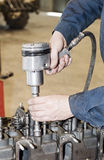 Engine repair. The tool in hands Stock Photo