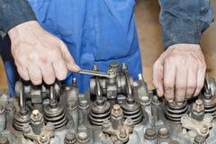 Engine repair. The tool in hands. Engine repair close up. In hands tool Royalty Free Stock Image